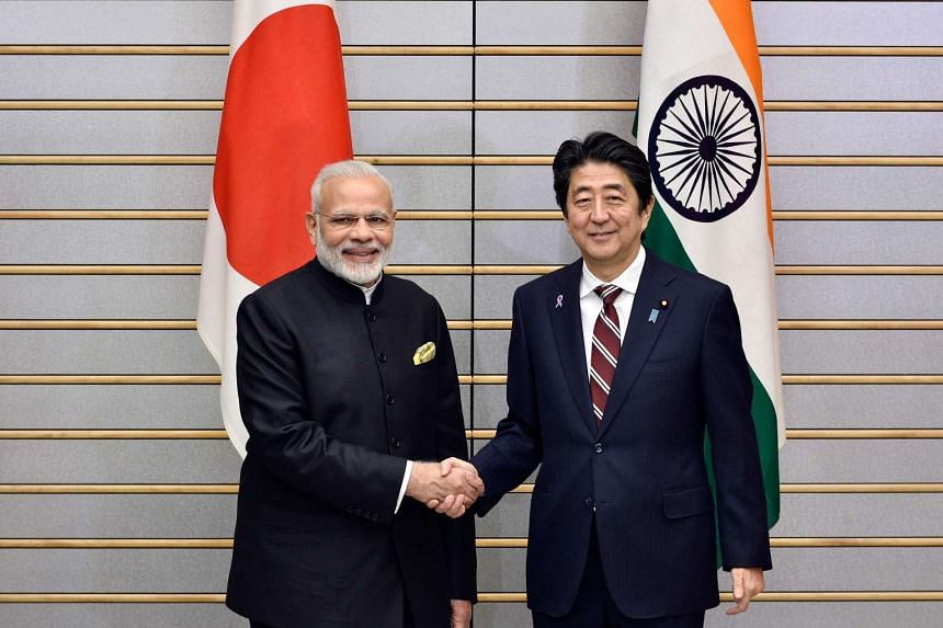 India's Prime Minister Narendra Modi (left) shakes hands with his Japanese counterpart Shinzo Abe at the start of their meeting at Abe's official residence in Tokyo on Nov 11, 2016.