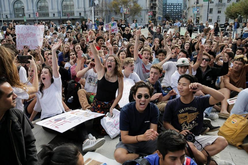 Students hold a sit-in in front of City Hall protesting the election of Donald Trump as President of the United States in San Francisco, California, US on Nov 10, 2016.