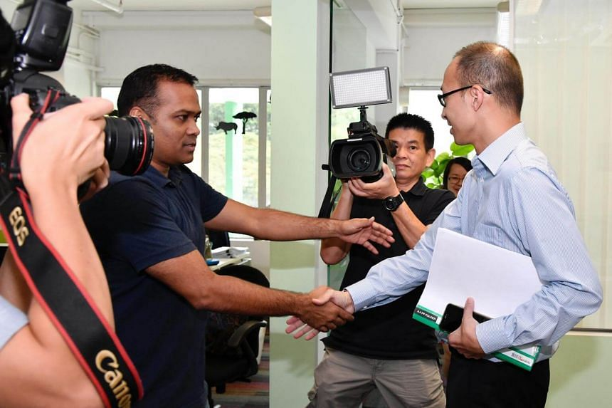 Mr Gerard Christopher, former assistant executive director of the Singapore Environment Council (SEC), shaking hands with Mr Edwin Seah before the inquiry at the SEC office.
