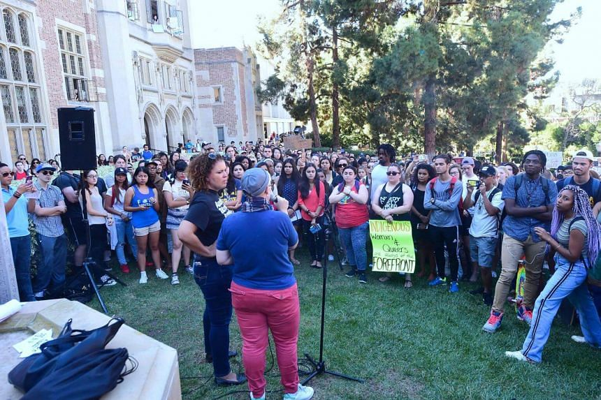 University of California Los Angeles students holding signs and listen to speeches before marching through campus on Nov 10, 2016 in Los Angeles, California, during a Love Trumps Hate rally.