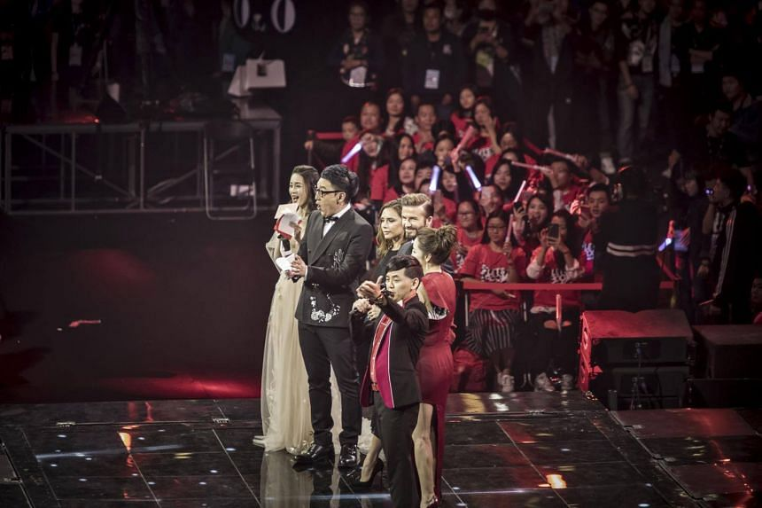Soccer celebrity David Beckham and wife Victoria Beckham appear on stage with the hosts of the event during the Alibaba 11.11 Global Shopping Festival Countdown Gala in Shenzhen, China on Nov 10, 2016.