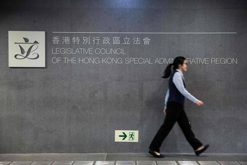 A women walking past a sign in the Legislative Council Building in Hong Kong on Nov 7, 2016.