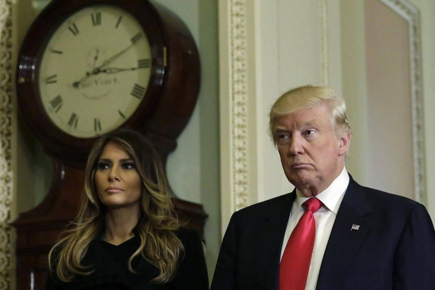 US President-elect Donald Trump talking to the media with his wife Melania Trump on Capitol Hill in Washington, DC, on Nov 10, 2016.