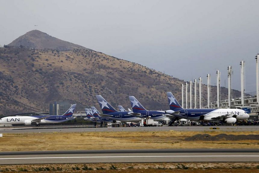 File photograph of LATAM Airlines planes parked at Santiago International Airport, Chile.