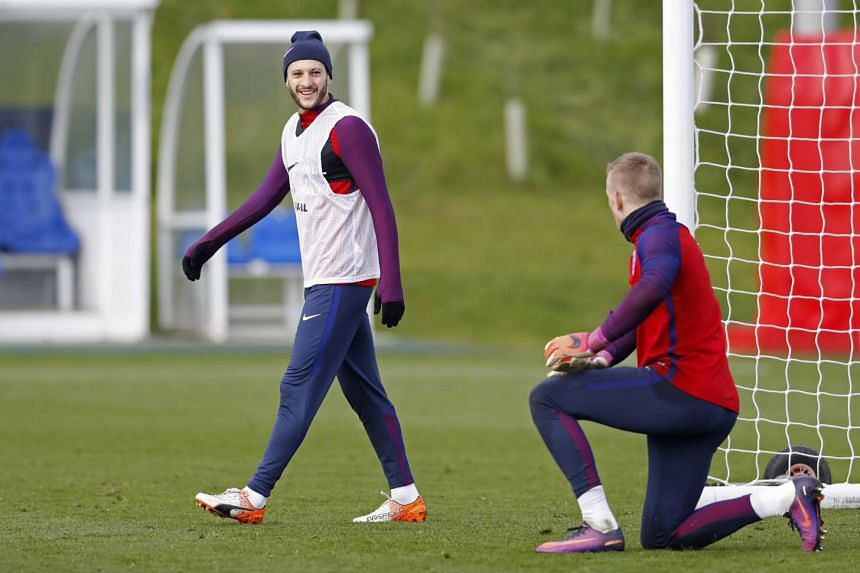 England's Adam Lallana and Jordan Pickford during training.