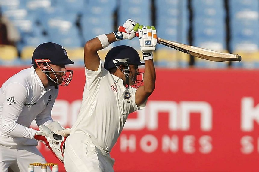 India's Gautam Gambhir (right) plays a shot watched by England's wicketkeeper Jonny Bairstow.