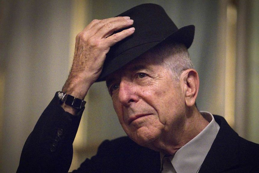Leonard Cohen  taking off his hat to salute in Paris, on Jan 16, 2012.