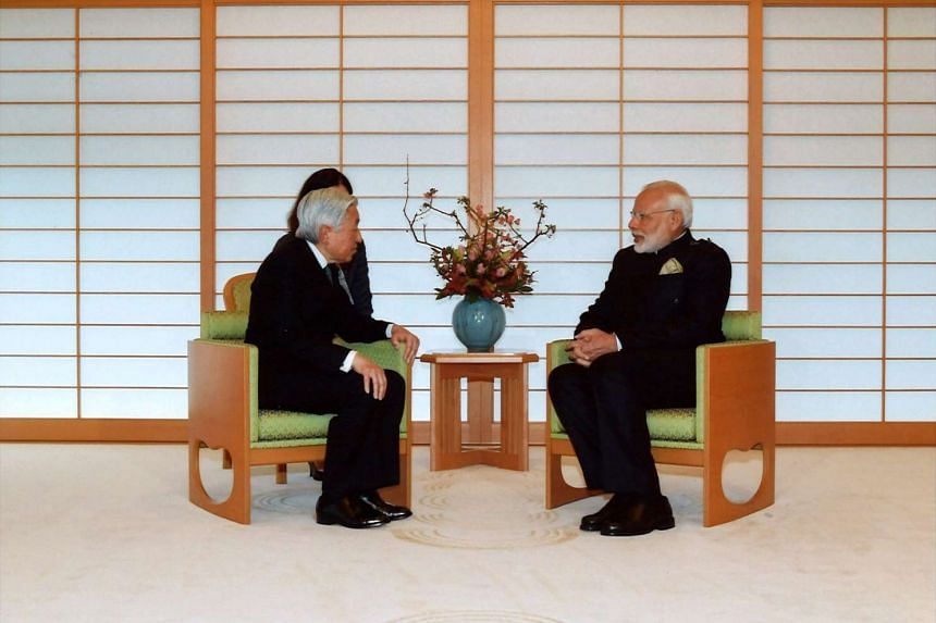 Indian Prime Minister Narendra Modi talks with Japan's Emperor Akihito during a meeting at the Imperial Palace in Tokyo, Japan on Nov 11, 2016.