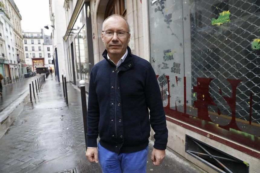 Claude Emmanuel Triomphe, injured during the November 13 Paris attacks, poses on Nov 4, 2016, in Paris.
