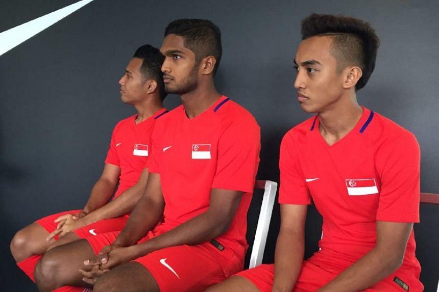 (From left) Sahil Suhaimi, Hariss Harun and Faris Ramli in the new national team jersey at Jalan Besar Stadium.
