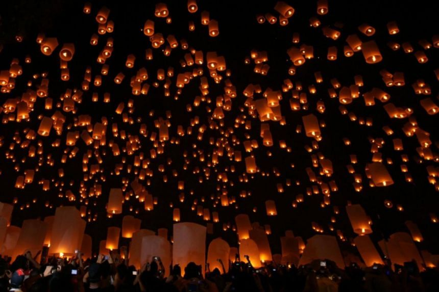 Lanterns being released for good luck in the Yi Peng Festival in Chiang Mai, Thailand.