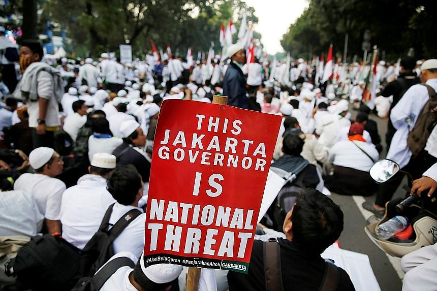 Members of hardline Muslim groups protesting against Jakarta Governor Basuki Tjahaja Purnama, a Christian, in the Indonesian capital last Friday.