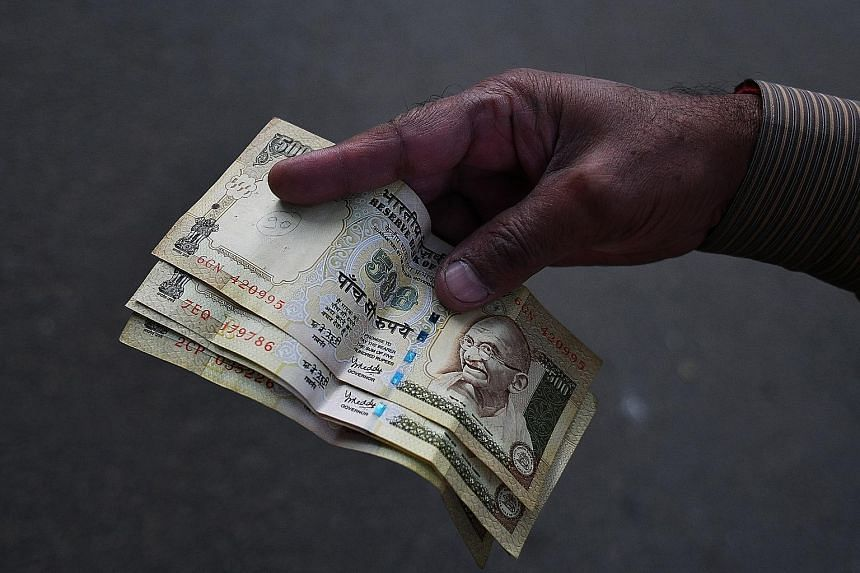 Money changers and Indian banks here are not accepting 500 and 1,000 rupee notes after they stopped being legal tender on Nov 8.