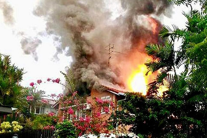 Fire hit the second storey of the bungalow in Sunset Place, with flames shooting through the roof, when firefighters arrived at the scene yesterday.