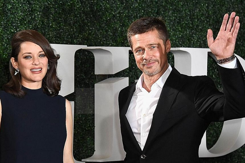 Actor Brad Pitt and his co-star Marion Cotillard at a red-carpet appearance at the premiere of their new film, Allied, in Los Angeles.