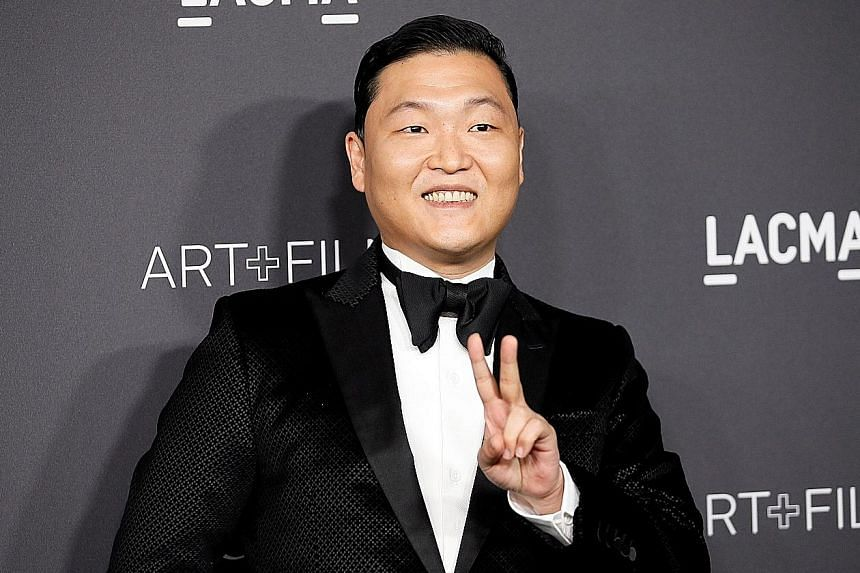 K-pop star Psy (left) has worked with artistic director Cha Eun Taek, an associate of Ms Choi's.
