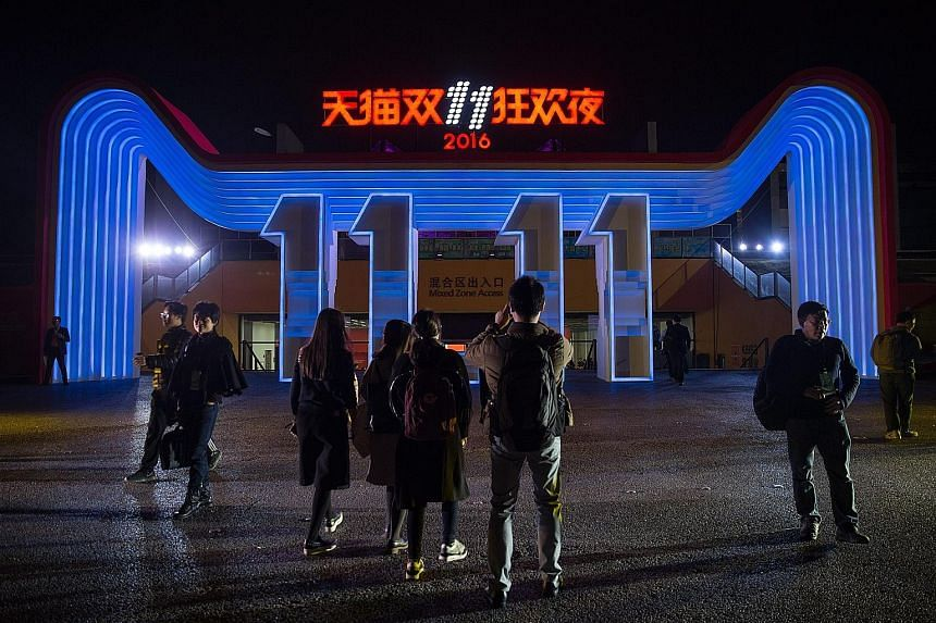 A light display for the Alibaba 11.11 Global Shopping Festival Countdown Gala outside the venue in Shenzhen yesterday. Alibaba organises a concert every year in the hours leading up to midnight, Nov 11.
