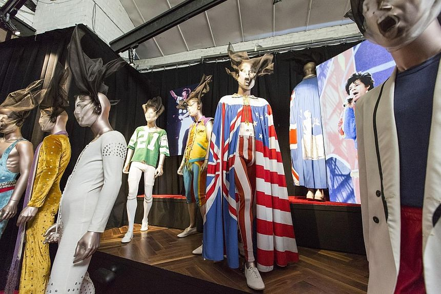 A colourful display of outfits worn by Mick Jagger over the years on display in Exhibitionism - The Rolling Stones.