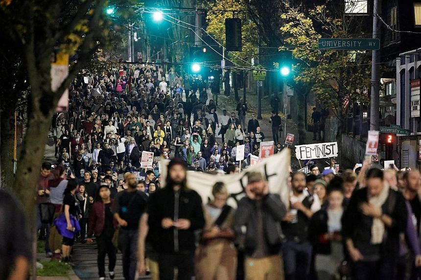 Protests took place in cities like (clockwise, from above) Los Angeles, where protesters shut down a major expressway; Chicago, where people gathered outside Trump Tower; and Seattle, where they marched through the streets.