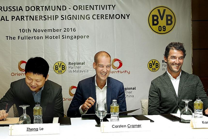 German Bundesliga football club Borussia Dortmund yesterday formalised a partnership with local sports and entertainment company Orientivity. The deal will see both parties help develop football in Asia, including holding football clinics with the cl