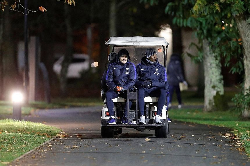 France players Antoine Griezmann and Paul Pogba on their way to training at Clairefontaine ahead of today's 2018 World Cup qualifier against Sweden. The teams are level at the top of Group A with seven points from three games.