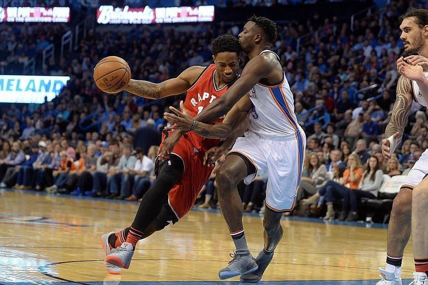 Toronto Raptors' DeMar DeRozan drives to the basket as Oklahoma City Thunder forward Jerami Grant attempts to stop the guard. After Wednesday's game-high 37-point performance, DeRozan leads the NBA in points per game (34.1). The Thunder's Russell Wes