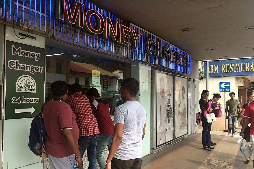 Money changers in Little India say more people have been approaching them to exchange the old 500 and 1,000 Indian rupees, which stopped being legal tender on Tuesday.
