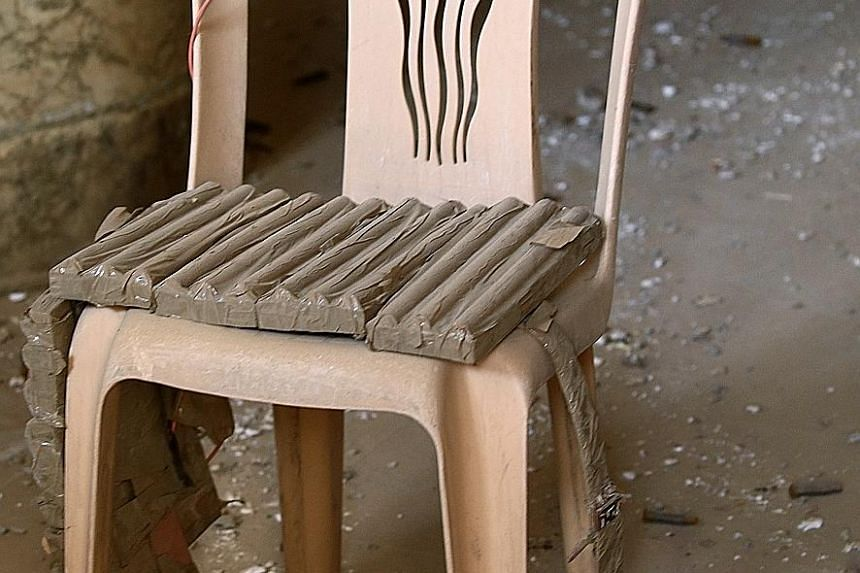An explosive belt belonging to ISIS militants is seen on a chair in Bashiqa. The Iraqi town was recaptured from ISIS as troops and allied militias advanced yesterday on villages held by the militants.