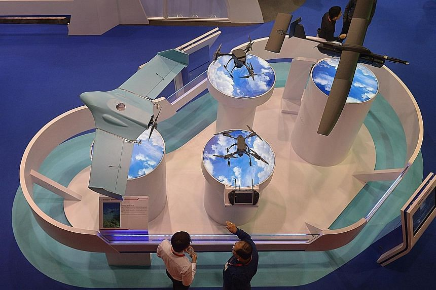 ST Engineering's drones and unmanned vehicles at the Singapore Airshow in February. The firm said it had a healthy order book of $11.4 billion as of Sept 30, although its operating environments remain challenged by uncertainties in the global economy