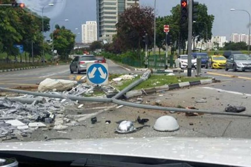 An accident involving a lorry and a car toppled a lamp post, causing congestion along Jurong Town Hall Road on Friday (Nov 11) afternoon.