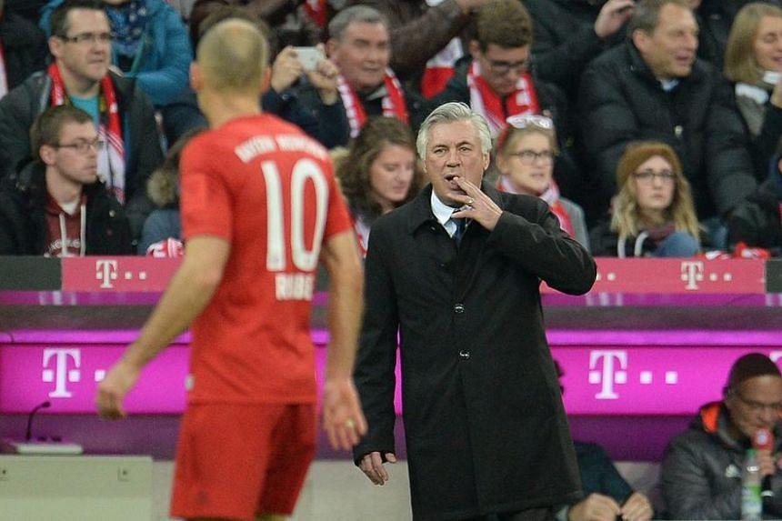Bayern Munich coach Carlo Ancelotti talks with Arjen Robben during a match.