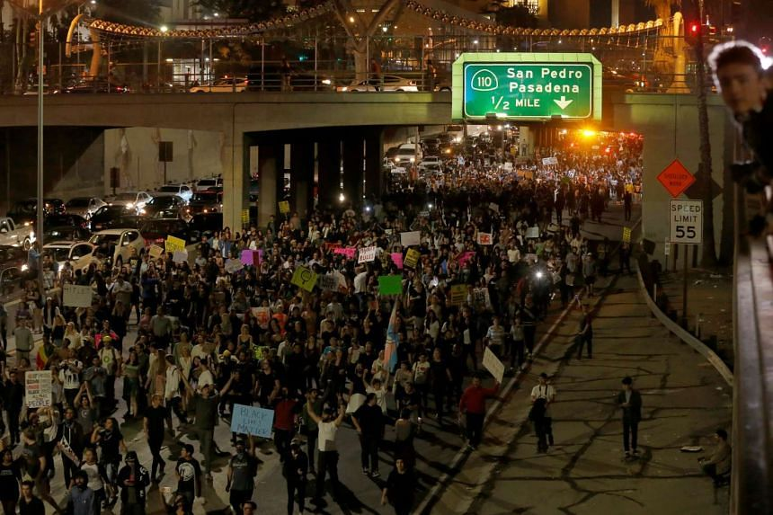 Demonstrators take over the Hollywood 101 Freeway in Los Angeles, California, Nov 10, 2016.