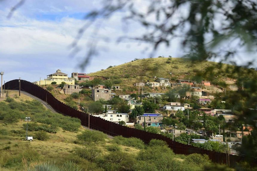 The residential neighbourhood of Nogales in the state of Sonora on the Mexico side of the border is seen across the border wall from Nogales, Arizona on Oct 12, 2016.