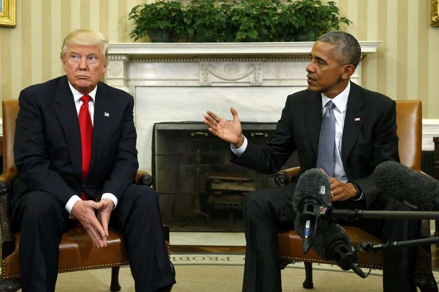 US President Barack Obama (right) meets with President-elect Donald Trump to discuss transition plans in the White House Oval Office in Washington, DC on Nov 10, 2016.