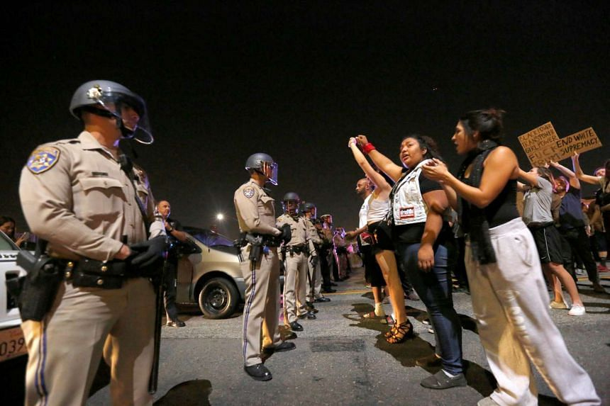Los Angeles police are deployed as demonstrators take over the Hollywood 101 Freeway.