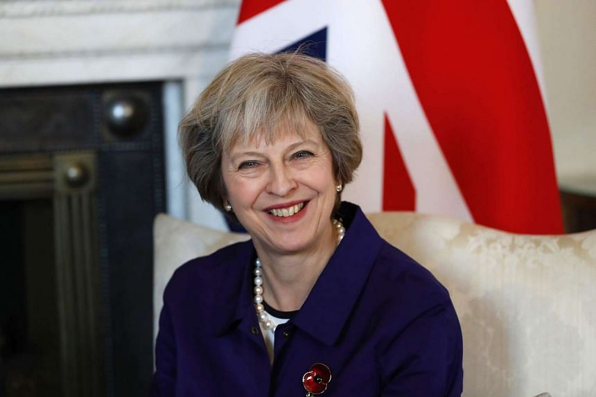 May (above) told Trump she hoped to strengthen bilateral trade and investment with the US as Britain leaves the EU.