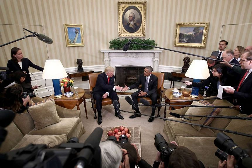US President Barack Obama (right) shakes hands with President-elect Donald Trump (left) following a meeting in the Oval Office on Nov 10, 2016 in Washington, DC.