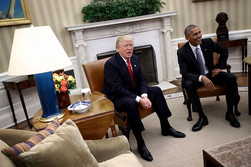 President-elect Donald Trump (left) talks after a meeting with US President Barack Obama (right) in the Oval Office on Nov 10, 2016 in Washington, DC.