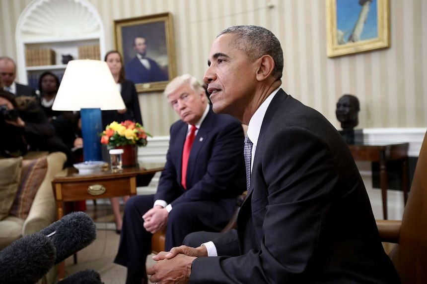 President-elect Donald Trump (left) listens as US President Barack Obama speaks during a meeting in the Oval Office on Nov 10, 2016 in Washington, DC.