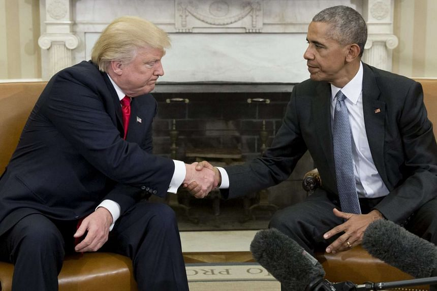 US President Barack Obama (right) shakes hands with President-elect Donald Trump (left) at the end of their meeting in the Oval Office of the White House in Washington, DC on Nov 10, 2016.