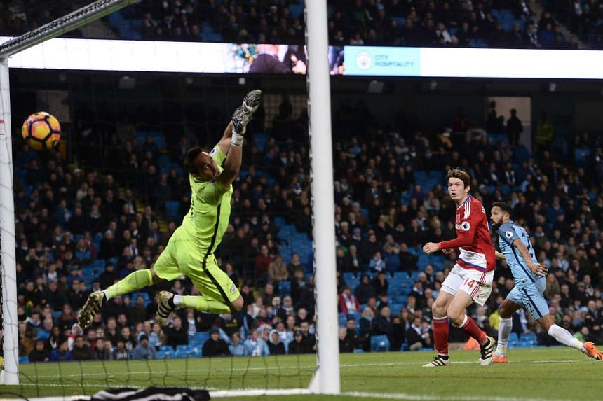 Middlesbrough's Dutch midfielder Marten de Roon (centre) beats Manchester City's Chilean goalkeeper Claudio Bravo (left) to score their first goal to equalise 1-1 during the English Premier League football match, on Nov 5, 2016.