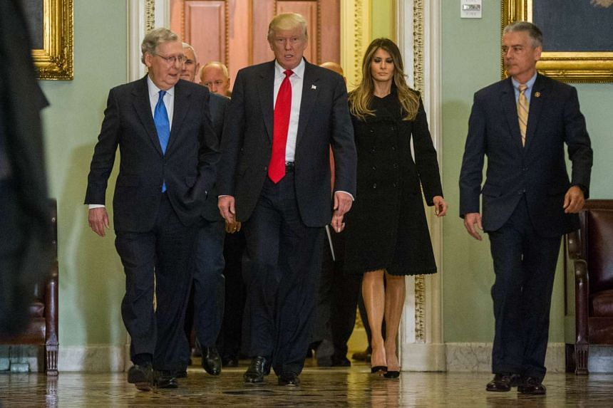 Senate Majority Leader Mitch McConnell walks with Trump to his office before a meeting at the Capitol Building on Nov 10, 2016 in Washington, DC.