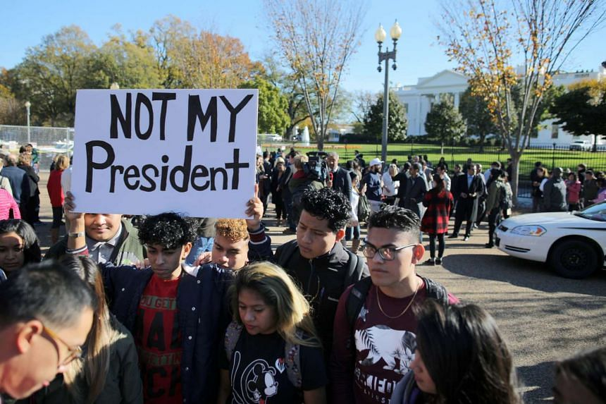 Protesters gather outside the White House US President-elect Donald Trump met US President Barack Obama on Nov 10, 2016.