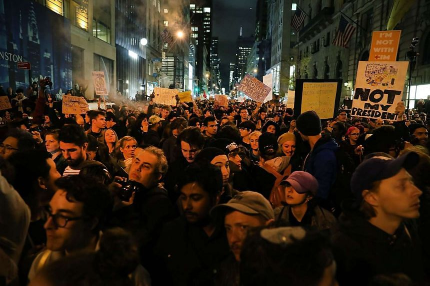 Anti-Trump protesters shut down 5th Avenue in front of Trump Tower as New Yorkers react to the election of Donald Trump as president of the United States on Nov 9, 2016, in New York City.