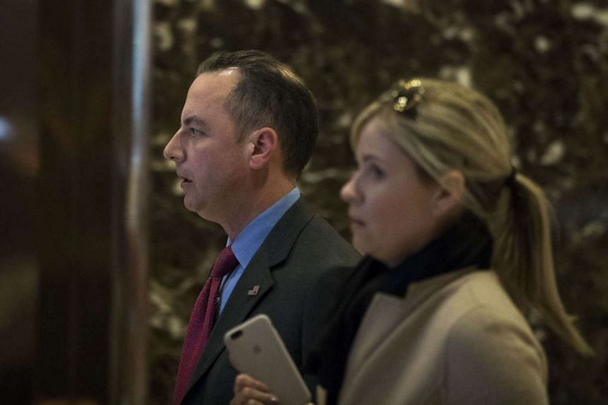 Republican National Committee chairman Reince Priebus arrives in the lobby of Trump Tower, Nov 11, 2016 in New York City.