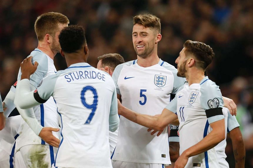 England defender Gary Cahill (centre) celebrates with teammates after scoring their third goal.