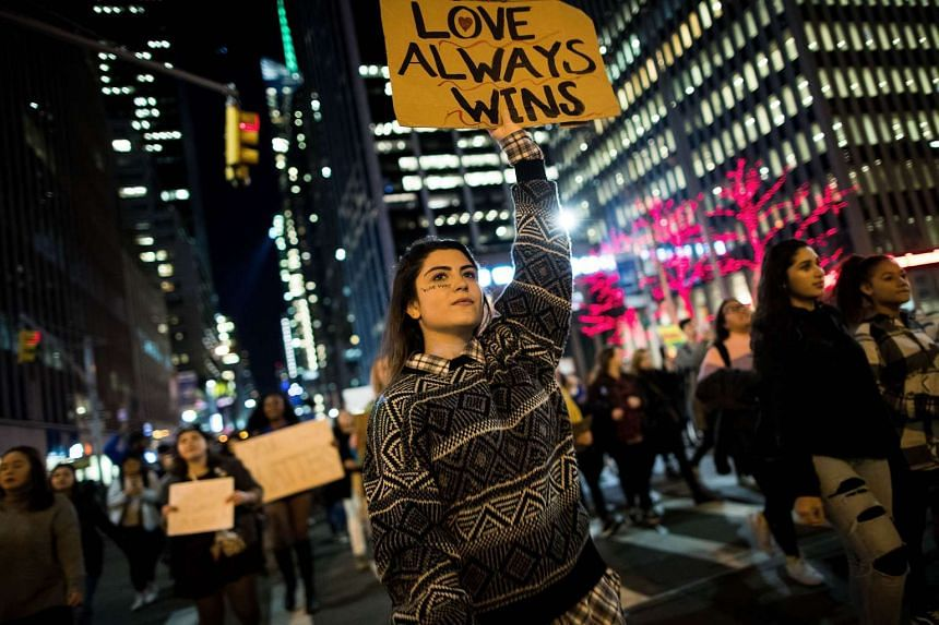 Anti-Donald Trump protesters march in the street on Fifth Avenue, Nov 11, 2016 in New York City.