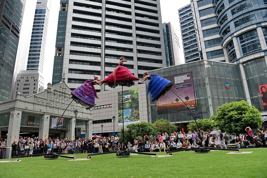 Swaying back and forth atop 5m-high poles, these performers from Australian company Strange Fruit Productions caught the attention of the lunchtime crowd at Raffles Place yesterday. The show, titled The Three Belles, was part of Arts In Your Neighbou