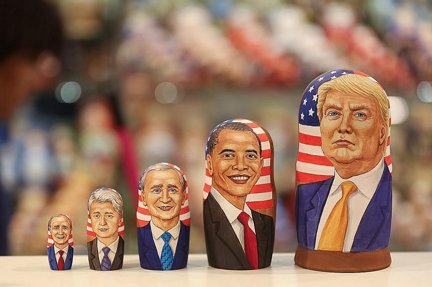 Russian nesting dolls depicting (from left) former US presidents George H.W. Bush, Bill Clinton and George W. Bush, President Barack Obama and President-elect Donald Trump at a souvenir store in Moscow on Wednesday. Mr Trump will be the first billion