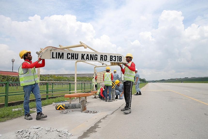Lamp posts and other fixtures along Lim Chu Kang Road, such as this bus stop, have been temporarily removed to turn the 2.5km stretch into a runway for the Republic of Singapore Air Force's Exercise Torrent this weekend. Taking their place is equipme
